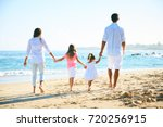 happy family enjoying walk on... | Shutterstock . vector #720256915