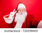 taking holly jolly x mas... | Shutterstock . vector #720298405