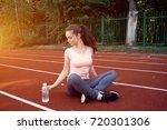 beautiful fitness athlete woman ...   Shutterstock . vector #720301306