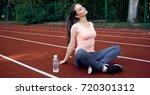 beautiful fitness athlete woman ...   Shutterstock . vector #720301312