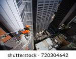 male industrial rope access... | Shutterstock . vector #720304642