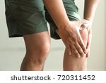 the knee man holds on suffering ... | Shutterstock . vector #720311452