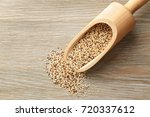 scoop with raw quinoa grains on ... | Shutterstock . vector #720337612