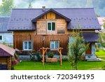 facade of a wooden house | Shutterstock . vector #720349195