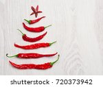 chilly peppers christmas tree | Shutterstock . vector #720373942
