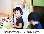 cute child playing indoors   Shutterstock . vector #720374596