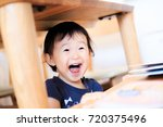 cute child playing indoors   Shutterstock . vector #720375496