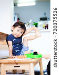 cute child playing indoors   Shutterstock . vector #720375526