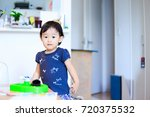 cute child playing indoors   Shutterstock . vector #720375532