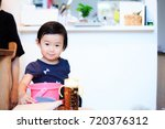 cute child playing indoors   Shutterstock . vector #720376312