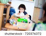 cute child playing indoors   Shutterstock . vector #720376372