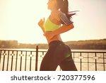 a sports girl runs through the... | Shutterstock . vector #720377596