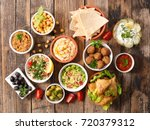 selection of libanese food mezze | Shutterstock . vector #720379312