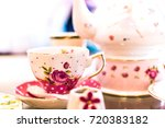 ceramic teapot and teacup on... | Shutterstock . vector #720383182
