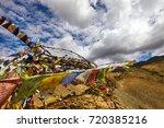 prayer flags in the wind | Shutterstock . vector #720385216