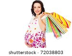 Smiley Pregnant Woman Holding...