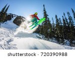 skier freerider jumping from a... | Shutterstock . vector #720390988