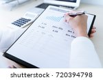 business women reviewing data... | Shutterstock . vector #720394798