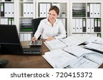 portrait of a happy accountant... | Shutterstock . vector #720415372