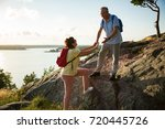active senior couple hiking on... | Shutterstock . vector #720445726