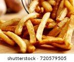 Crisp golden deep fried french fries; hot potatoes frying and ready to be eaten... yum!