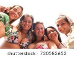 group of friends posing at the... | Shutterstock . vector #720582652