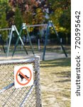 Small photo of Dogs forbidden sign on a gird fence