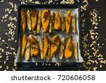baked pumpkin with rosemary and ... | Shutterstock . vector #720606058