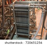 Small photo of Commercial plate heat exchanger in use in a brewery or distillery