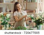 young woman florist occupation... | Shutterstock . vector #720677005