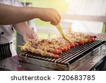 asian men are cooking barbecue...   Shutterstock . vector #720683785