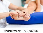 medical massage at the foot in... | Shutterstock . vector #720709882