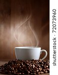 warm cup of ciffee on brown background - stock photo
