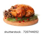wooden board with roasted... | Shutterstock . vector #720744052