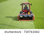Man in tractor aerating a...