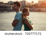 young couple having conflict... | Shutterstock . vector #720777172