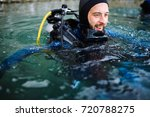 male diver swimming at water... | Shutterstock . vector #720788275