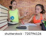 two girls with lots of books... | Shutterstock . vector #720796126