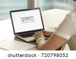 businesswoman looks at laptop... | Shutterstock . vector #720798052