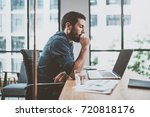 young pensive coworker working... | Shutterstock . vector #720818176