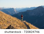 hiker in high altitude rocky... | Shutterstock . vector #720824746