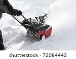 Man Removing Snow After Storm...