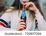 Woman Drinking Pepsi In The Bar