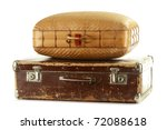 Two old travel suitcases isolated on white - stock photo