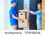 smiling delivery man in blue...   Shutterstock . vector #720938206