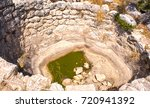 ancient stone abandoned well in ... | Shutterstock . vector #720941392