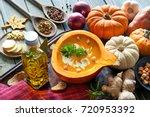 spicy pumpkin soup seasoned... | Shutterstock . vector #720953392