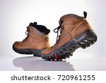 A Pair Of Brown Hiking Boots In ...
