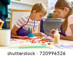 portrait of two kids  boy and... | Shutterstock . vector #720996526