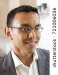 Small photo of Closeup portrait of young man in eyeglasses and business garb